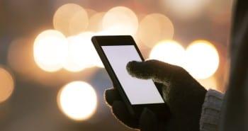 bright smartphone screen at night blue light